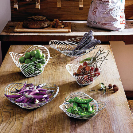 Trinity collection by Alessi. Fruit bowls, baskets and centerpieces for the kitchen