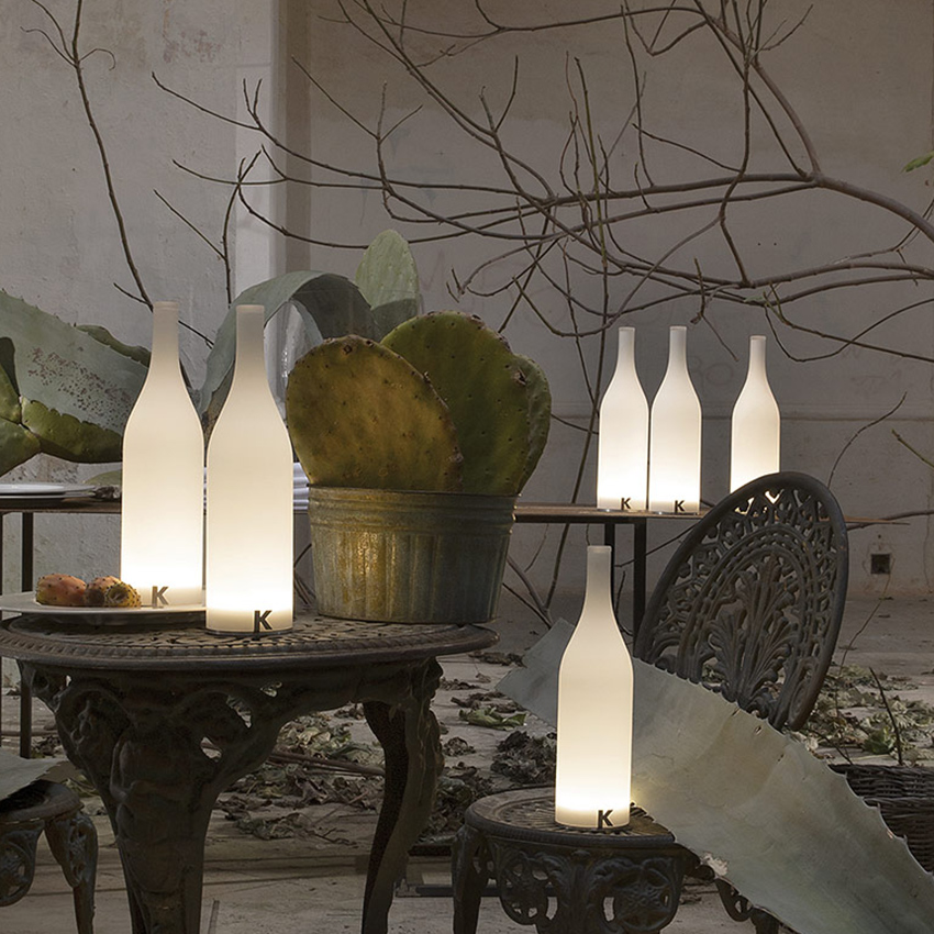 Bottle-shaped wireless table lamps from the Bacco collection by Karman