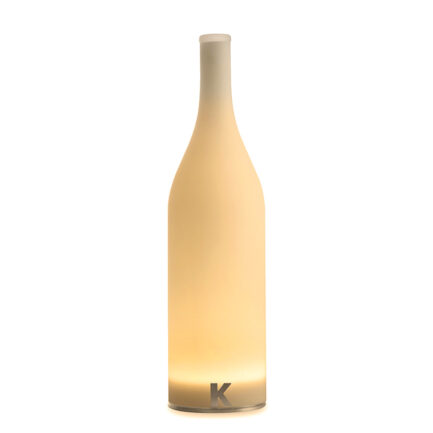 Bottle-shaped wireless table lamp from the Bacco collection by Karman with warm light