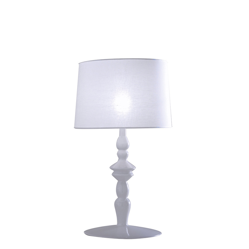 Small classic table lamp with white ceramic structure and white linen lampshade from the Alì Babà collection Karman