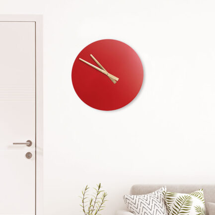 Basic modern wall clock made by the company I Details in red color with gold leaf hands